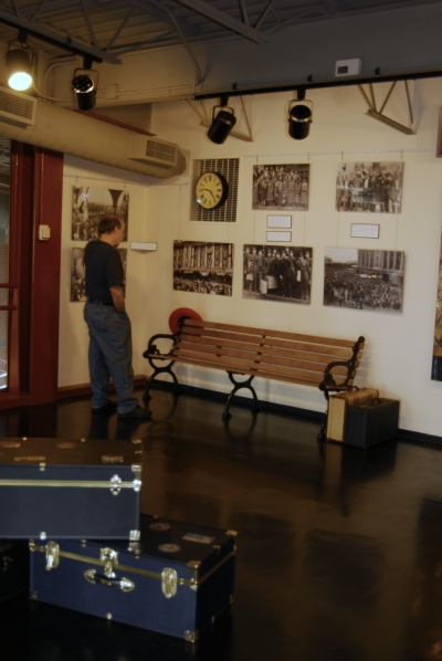 A visitor examines the newest exhibit images and text on display at Steamtown NHS.
