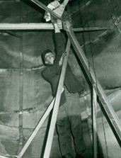 A worker inside the Statue's interior making improvements during the 1980s restoration.