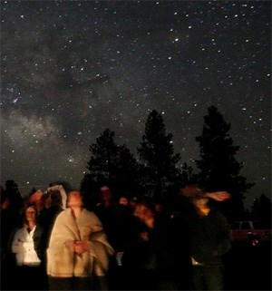 Park visitors participate in a ranger's green laser tour at the Bryce Canyon Astronomy Festival, Utah.