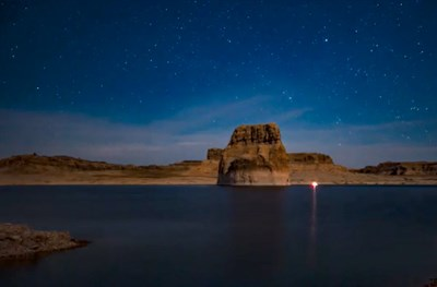 Night view of starry sky over rock forms at Lake Powell, Glen Canyon National Recreation Area.