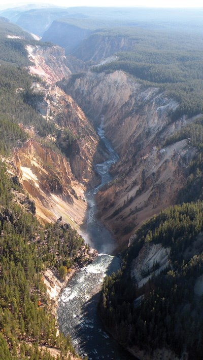 Overhead view of the Grand Canyon of the Yellowstone, with the Lower Falls at the bottom of the scene, and the canyon extending to the top of the scene.