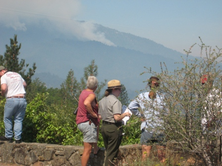 Park Ranger speaks to visitors about fires burning on Shasta Bally seen in background.