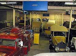 (Bldg 2009) This image depicts a portion of the historic vehicles currently in storage. Some of the vehicles have had their dust covers temporarily removed to illustrate the different models represented in the collection.