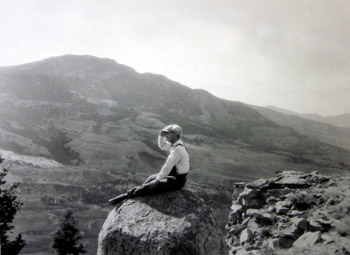 Possibly H. E. Stork, sitting on rock outcropping on Mt. Everts, 1929.