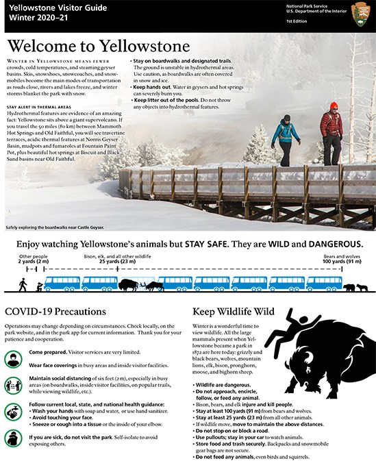 Cover page of the visitor guide with two people walking on a snow-covered boardwalk.