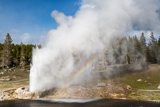 Rainbow in steam from a geyser eruption