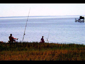 Two people fishing in the James River.