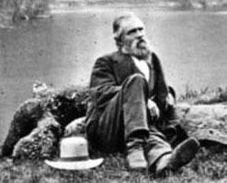 Galen Clark sits beside a Yosemite lake