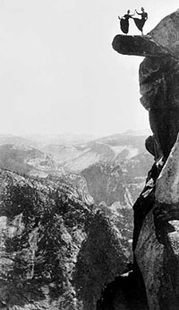 Kitty Tatch and Katherine Hazelston, waitresses at Yosemite National Park hotels, dance on Overhanging Rock at Glacier Point in 1900