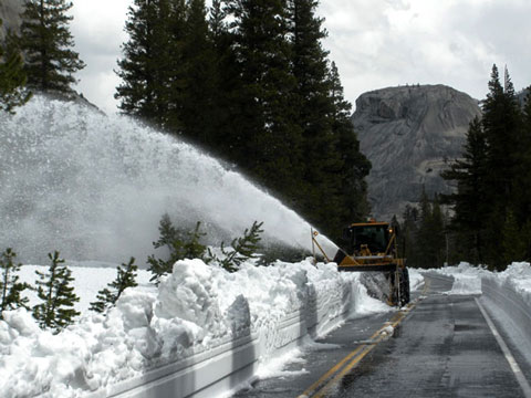 Plow removing snow from Tioga Road