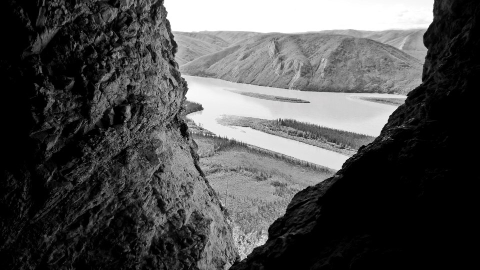 View of the Yukon River from the entrance of a cave high on a bluff