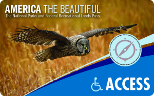 Image of Access Pass showing flying owl, blue stylized compass. Text at top left reads: America The Beautiful The National Parks and Federal Recreational Lands Pass. Text at lower right reads: ACCESS