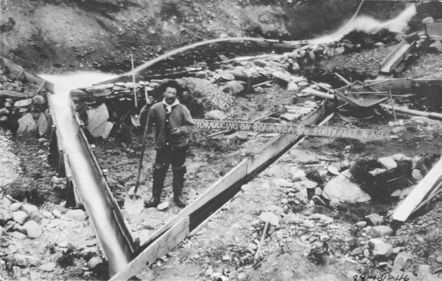 Hydraulicking with sluices boxes near the Fortymile River , ca. 1915.