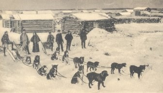 Historic photo of Downing's sleds prepared to leave Circle, Alaska.