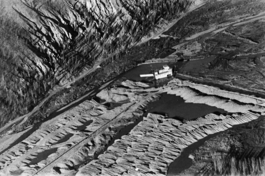 Aerial view of Woodchopper dredge and tailings, ca. 1938.