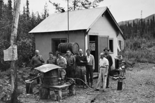 McRae, Patty, and friends watching the process of removing mercury from gold, circa 1930s.