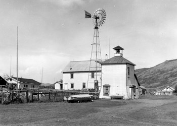 The Eagle wellhouse (foreground), which still supplies the town's water, and Wickersham courthouse, 1938.