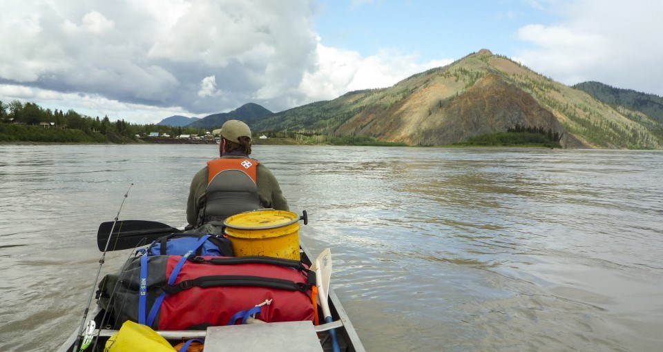 A canoeist on the Yukon River in front of Eagle