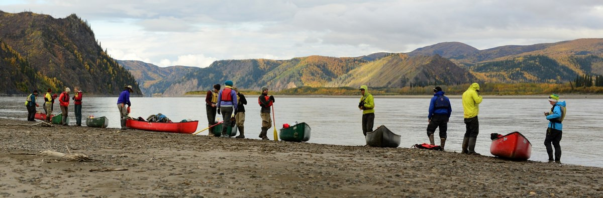 A group canoeing on the Yukon River